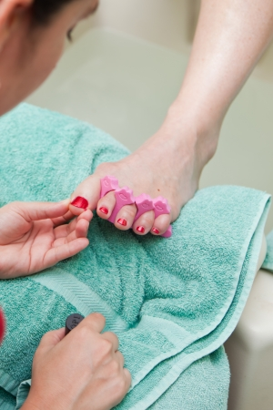 close up of a spa treatment, pedicure on a caucasian womans feet photo