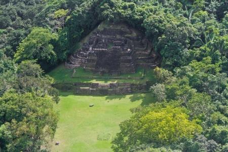 atone: aerial view of the Jaguar Temple in Lamanai maya ruins in the tropical jungle of Belize