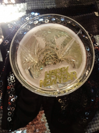 print: Happy new year in gold print trough a glass of champagne