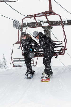 young couple snowboarding in northern Idaho with snowy conditions photo