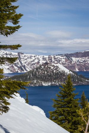 Wizard Island in Crater Lake national park in Oregon early spring with some snow left from winter photo