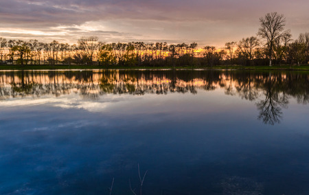 beautiful sunset with a reflection over a small lake in Illinois
