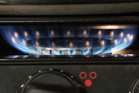 gas stove: close up of  gas burner on a motorhome stove