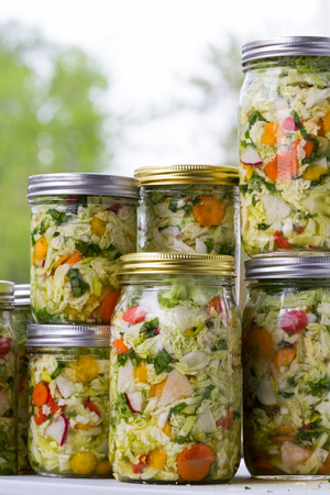 home made cultured or fermented vegetables in  glass jars