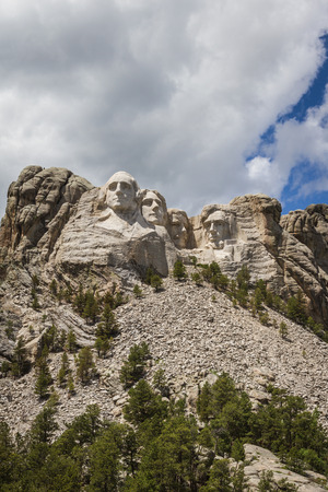 view of Mount Rushmore National Monument on a spring morning with some clouds and sunshine photo