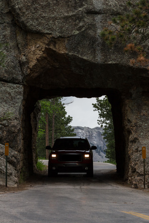 traveling from mount Rushmore with a view from a distant road tunnel