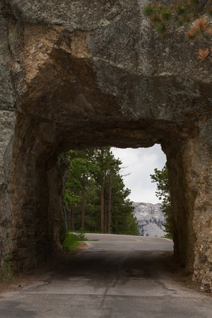 view of mount Rushmore from a distant road tunnel