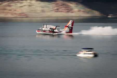 lost lake: Lost Creek Lake, Oregon  - September 7 : Supperscooper plane scoping water out of Lost Creek Lake to fight the 790 fire, September 7 2014 in Lost Creek Lake, Prospect Oregon
