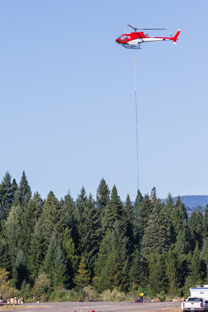 Prospect State Airport, Oregon  - September 9 : Helicopter moving supplies to and from the base of the 790 fire,September 9 2014 in Prospect State Airport, Prospect Oregon
