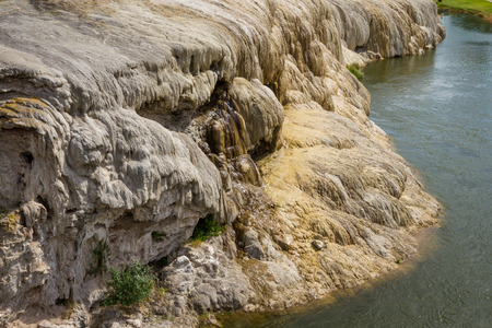 accumulating: mineral hot springs in thermopolis wyoming with mineral sediment accumulating in the water Stock Photo
