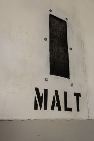 distillers: close up of an industrial size malt sign found at an alcohol distillery Stock Photo