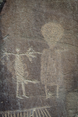 interpret: ancient depictions or petroglyphs found in wyoming. some thought to be over 10000 years old