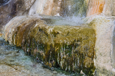 residue: close up of hot water springs leaving a mineral residue with colors and shapes