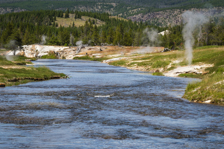 vents: river flowing thru Yellowstone with steam vents near the shore Stock Photo