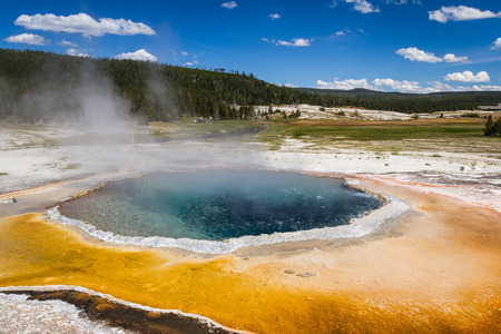 stemming: beautiful landscape in Yellowstone nations park with stemming geysers and vivid colors