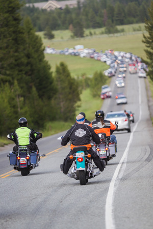 Yellowstone national park, Wyoming - July 14 : traffic jam due to roadside wildlife; July 14 2014 in Yellowstone national park, Wyoming