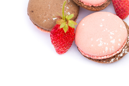 delicious french macaroons and wild strawberries isolated on a white background photo