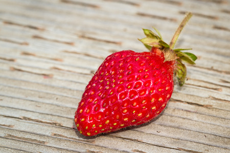 fresh picked strawberry on a wooden background