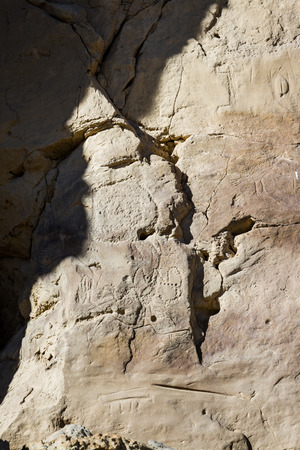 chaco: ancient petroglyphs or rock engravings on the dessert walls of Chaco Canyon New Mexico Stock Photo