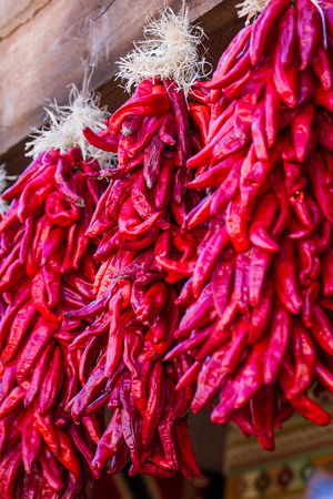 fe: hanging red chili ristras in Santa Fe New Mexico