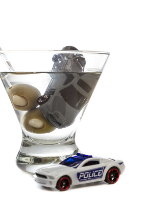 Image of a drunk driving accident with a vodka martini  isolated on a white background photo