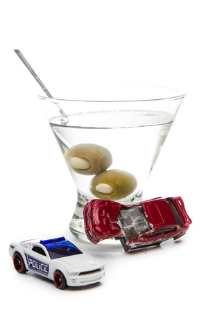 dwi: DUI concept. Image of a drunk driving accident with a vodka martini  isolated on a white background