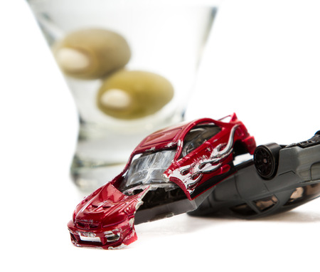 under the influence: Image of a drunk driving accident with a vodka martini  isolated on a white background