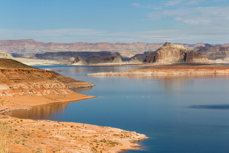 navajo land: beautiful view of lake Powell with navajo Sandstone contrasting with the blue water
