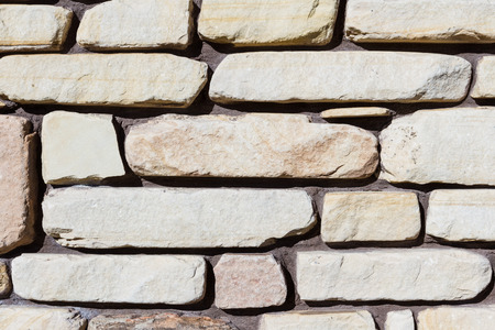esthetics: stone wall close up with different sizes and shapes for a natural background Stock Photo