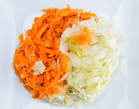 enhanced health: fermented vegetables o n a white plate arranged in a ting hand concept