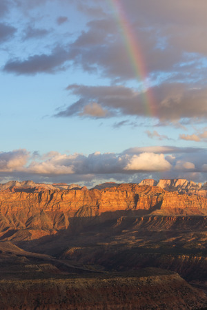 southwestern: pretty rainbow over the red sandstone mountains in southwestern Utah, parts of Zion NP