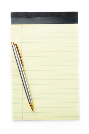 reminder concept: close up of a small note pad and a pen as a reminder concept