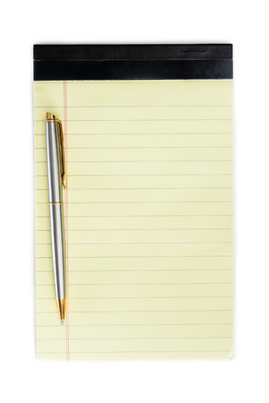 close up of a small note pad and a pen as a reminder concept