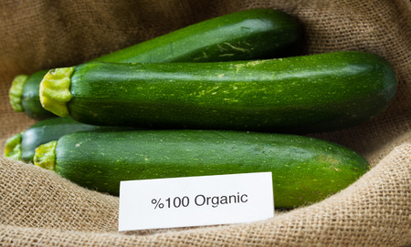 burlap sac: close up of fresh organic zucchini or green squash with a burlap sac as a background Stock Photo