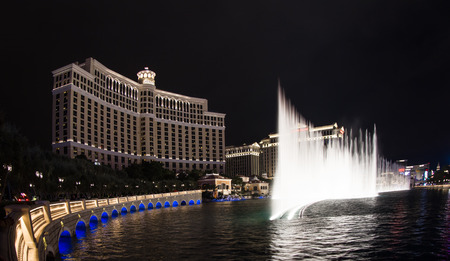 bellagio fountains: Las Vegas Nevada - December 16 : Dancing fountains synchronized to music displaying a beautiful show several times a night in front of The Bellagio Hotel and casino, December 16 2014 in Las Vegas, Nevada
