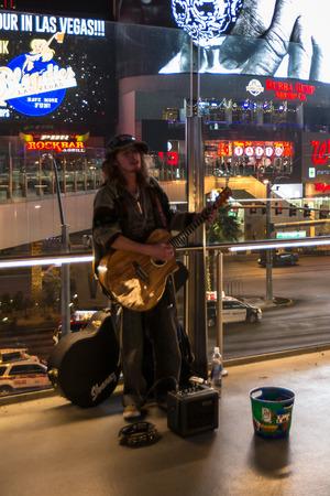 beggar's: Las Vegas Nevada - December 18 : Homeless man in Las Vegas playing a guitar and singing for tips, December 18 2014 in Las Vegas, Nevada Editorial