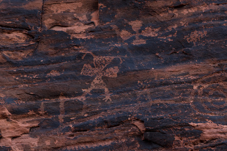 depictions: ancient petroglyphs fount on the walls of the the Mouses Tank hiking trail in Valley of Fire State Park, Nevada