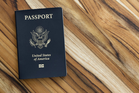 close up of an american passport on a wooden table for a travel concept Stock fotó