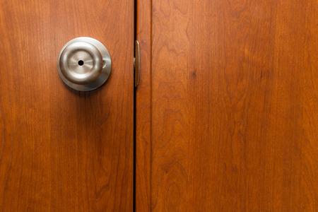 close up of a closed door with a brass knob Banco de Imagens