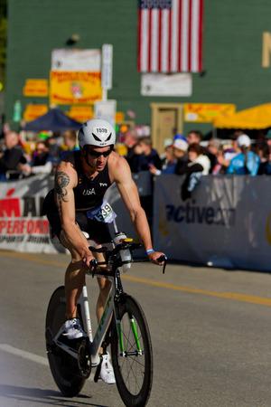 alene: COEUR D ALENE, ID -  JUNE 23: Nicholas Hansen Triathlete on the bike part of the ironman triathlon, June 23 2013 in Coeur d Alene Idaho