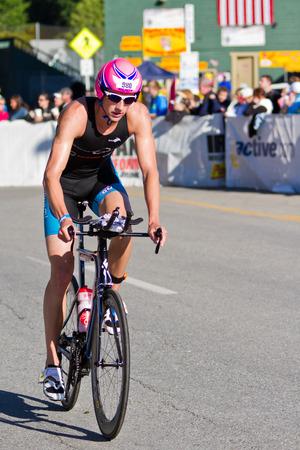 coeur: COEUR D ALENE, ID -  JUNE 23: Matthew Shanks, Triathlete on the bike part of the ironman triathlon, June 23 2013 in Coeur d Alene Idaho