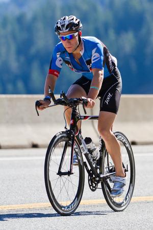 alene: COEUR D ALENE, ID -  JUNE 23: Daniel Metcalf, Triathlete on the bike part of the ironman triathlon, June 23 2013 in Coeur d Alene Idaho Editorial