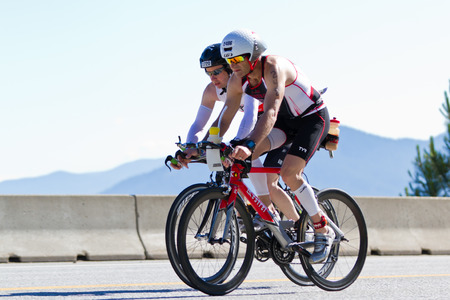 alene: COEUR D ALENE, ID -  JUNE 23: Triathlete on the bike part of the ironman triathlon, June 23 2013 in Coeur d Alene Idaho