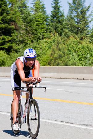 alene: COEUR D ALENE, ID -  JUNE 23: Lewis Elliot, Triathlete on the bike part of the ironman triathlon, June 23 2013 in Coeur d Alene Idaho