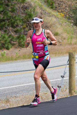 alene: COEUR D ALENE, ID - JUNE 23: Caitlin Snow. second place winner triathlete shown in the running event of the ironman in June 23 2013 in Coeur d Alene Idaho