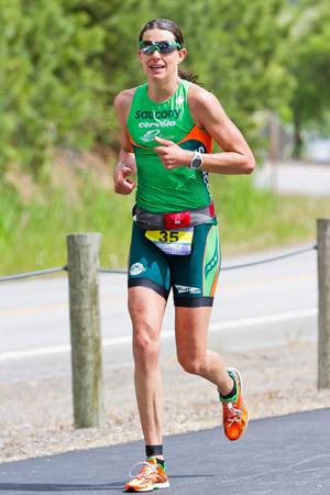 alene: COEUR D ALENE, ID - JUNE 23: Female winner Heather Wurtele, triathlete in the running event of the ironman in June 23 2013 in Coeur d Alene Idaho Editorial