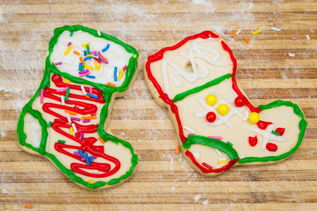 home made and decorated christmas cookies on a wooden background photo