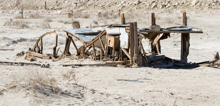 the remains and standing frames of the once popular town Bombay Beach in the Salton Sea, California. Stock Photo