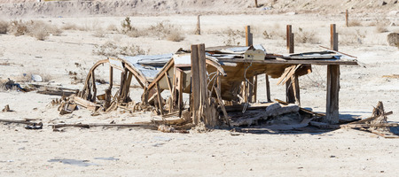 destructed: the remains and standing frames of the once popular town Bombay Beach in the Salton Sea, California. Stock Photo