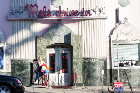 hollywood   california: Hollywood, California - February 08 : Street view of the sign for he famous Mels Drive-In, February 08 2015 in Hollywood, California. Editorial